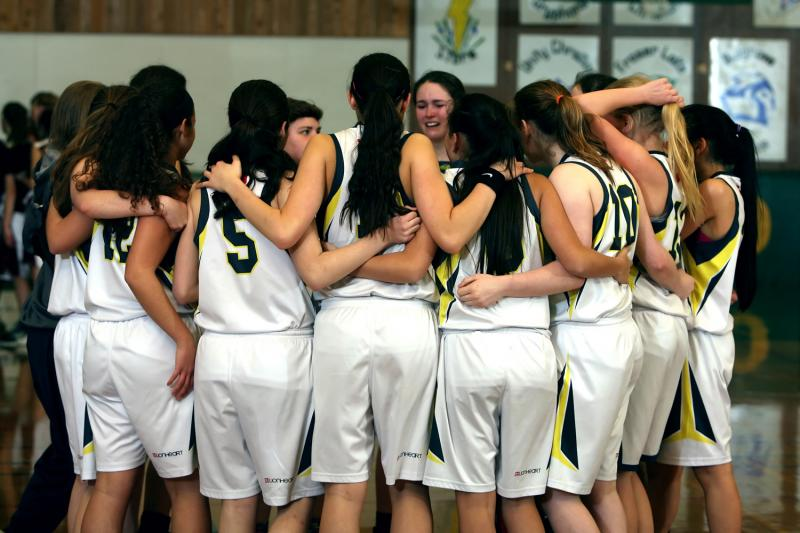 girls team huddling after game