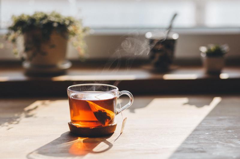black tea on table in sun