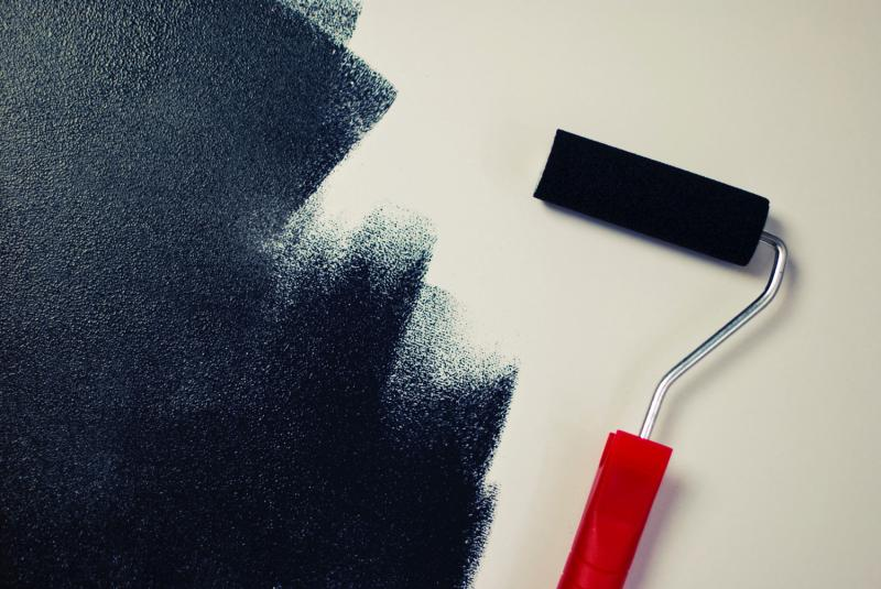 black paint and roller